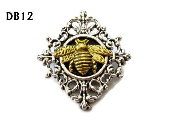Lapel badge, DB12,  Gold Bee design, diamond shaped silver setting (34x37mm)