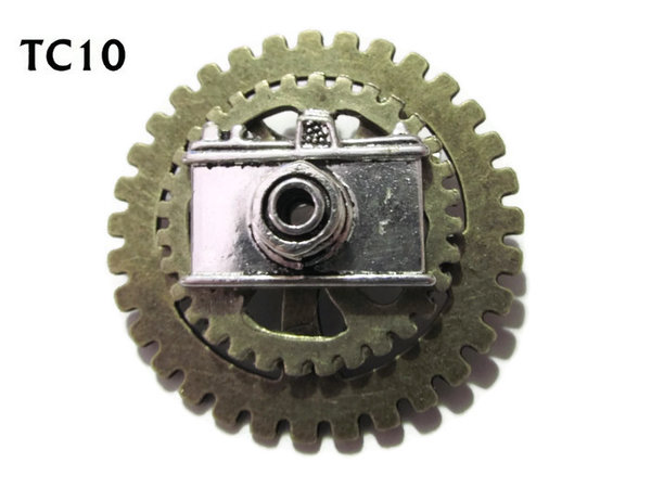 Badge / Brooch, TC10, Photographer , Stacked Gears (40mm dia approx) silver camera