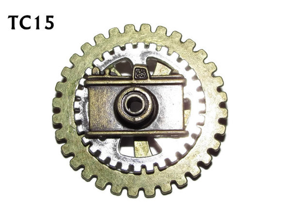Badge / Brooch, TC15, Photographer, Stacked Gears (40mm dia approx) bronze camera