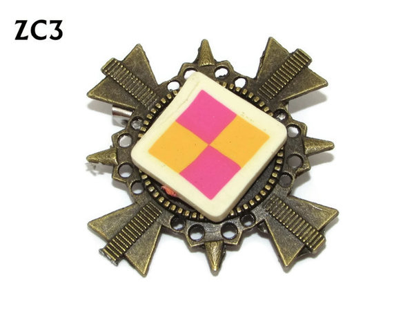 Badge / Brooch. ZC03, Battenburg!, bronze cross backing. (35x35mm)