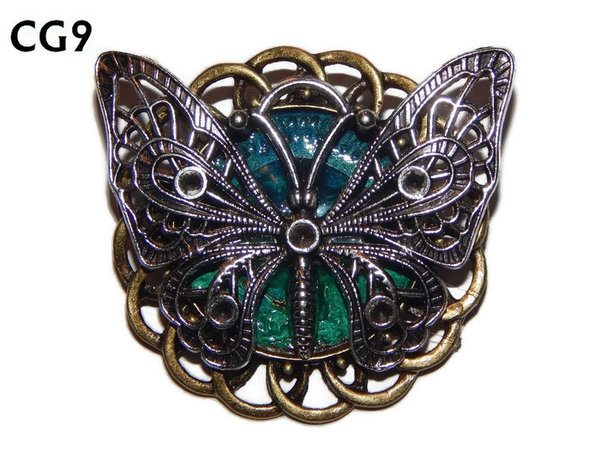 Badge / Brooch, CG09, Butterfly silver, Green/Blue, Round Curly Edge, (44mm dia)