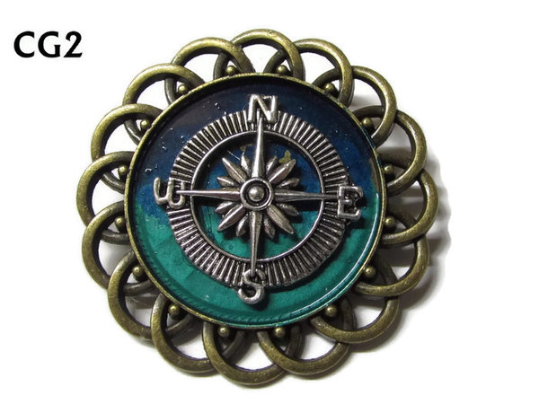 Badge / Brooch, CG02, Compass - silver, Green/Blue, Round Curly Edge, (44mm dia)