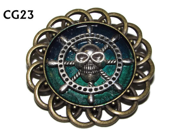Badge / Brooch, CG23, Skull Ships Wheel, Green/Blue, Round Curly Edge, (44mm dia)