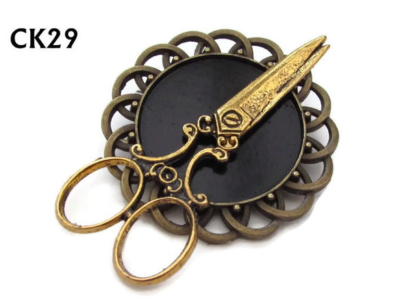 Badge / Brooch, CK29, Scissors gold, Black, Round Curly Edge, (44mm dia)