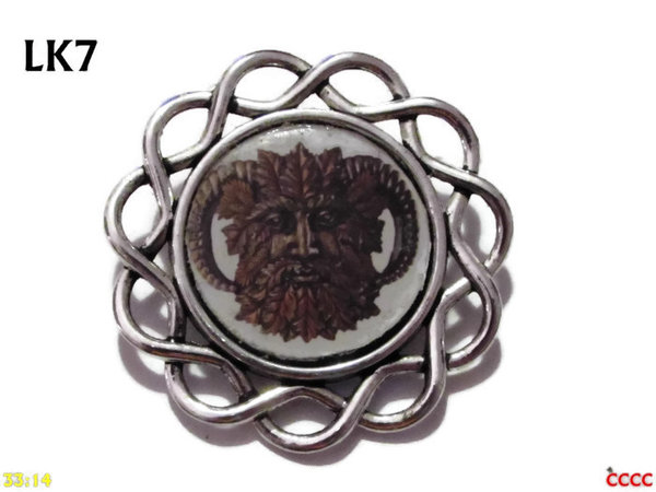 Badge / Brooch, LK07, Green Man design set in loopy curly edged backing (34mm dia.)