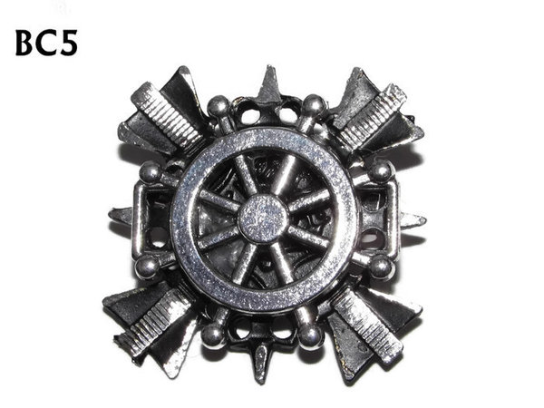 Badge/ Brooch, BC05, Ships Wheel design black cross. (35x35mm approx)