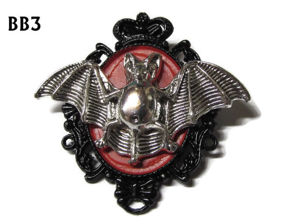 Badge / Brooch, BB03, Silver Bat on red & Black oval backing (36x47mm)