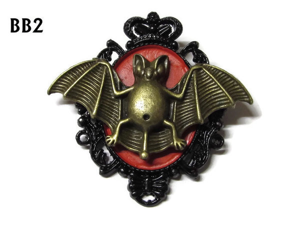 Badge / Brooch, BB02, Bronze Bat on Red & Black oval backing (36x47mm)