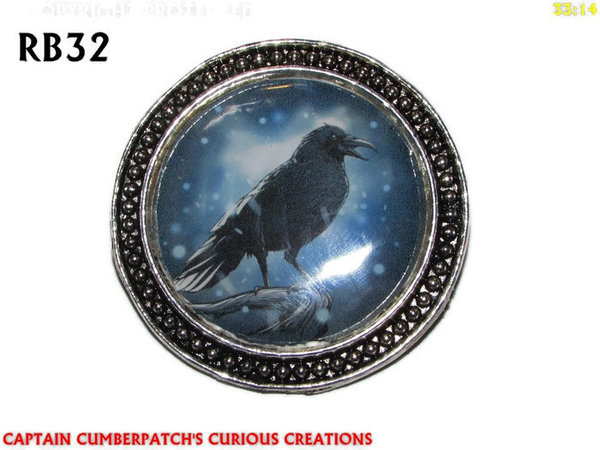 Badge / Brooch, RB32, Raven Graphic - Snow, silver setting (39mm dia.)