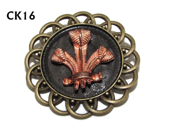 Badge / Brooch, CK16, Prince of Wales Feathers rosegold, Black, Round Curly Edge, (44mm dia)