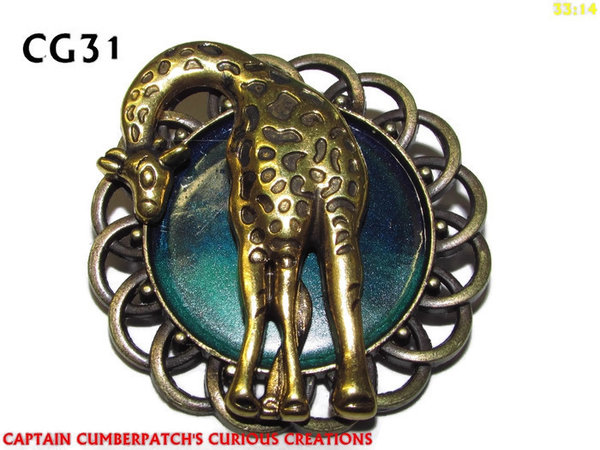 Badge / Brooch, CG09, Brass Giraffe, Green/Blue, Round Curly Edge, (44mm dia)